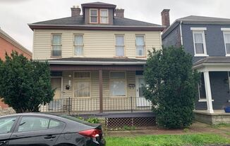Spacious 1 Bedroom 1/2 Double with Basement & Extra Room
